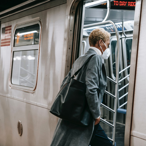 woman getting on a subway train