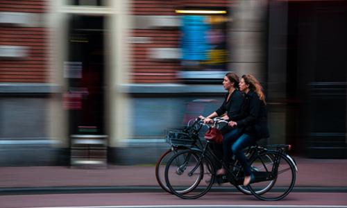 2 women cycling